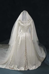 Wedding gown with matching veil, Duchesse satin acetate and nylon tulle, 1948. Made by Willie Otey Kay for Carolyn Dorcas Maynor. Embellished by Elizabeth Otey Constant with glass and pearlized seed beads. Museum Collection