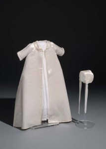 Baptismal ensemble, satin acetate and cotton, embellished with cotton insertion lace, hand-tatted cotton lace, synthetic chiffon, and satin acetate ribbon, 1947. Made by Willie Otey Kay for Ralph Campbell Jr. Museum Collection