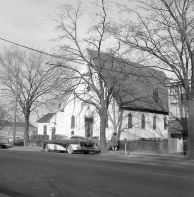 Saint Ambrose's congregation formed in 1868, shortly after the end of slavery. The board-and-batten wood-frame structure pictured here was constructed in 1879 and moved in 1900 from its original location on Lane Street to the corner of Cabarrus and Wilmington Streets. The congregation moved again in 1965 to a new building in the Rochester Heights neighborhood. Courtesy of the State Archives of North Carolina