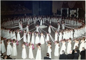 Historically a young woman's debut was a public announcement of her eligibility to marry. Here, participants in the 1967 North Carolina Debutante Ball perform the traditional cartwheel dance. Willie Kay designed for clients who had the means and status to participate in such functions. Courtesy of Mrs. Elizabeth Converse