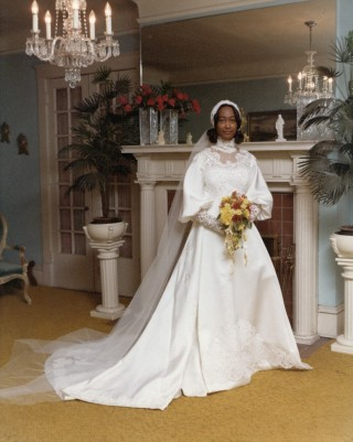 Rose Elaine Curtis tries on her wedding ensemble in Willie Kay's home. Courtesy of Mr. Ralph Campbell Jr. / Copyright Count Hayes Photography, Raleigh
