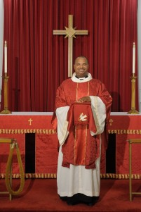 The Reverend Robert Jemonde Taylor, who became rector of Saint Ambrose in 2012, wears the chasuble and stole during worship. Courtesy of the North Carolina Museum of History