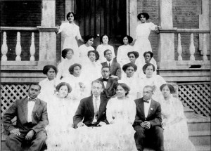 Willie Otey (standing on porch, upper left) and her classmates on the steps of Estey Hall at Shaw University, ca. 1912. Courtesy of the State Archives of North Carolina