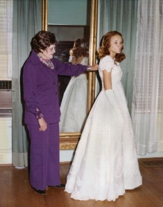 Mildred Otey Taylor, who ran her own dressmaking business, fits her granddaughter Carmen Taylor's debutante dress in 1976. Courtesy of Mrs. Bessie Taylor