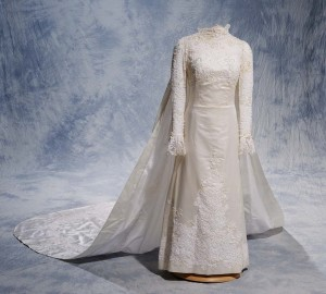 Wedding gown with matching veil, satin acetate with nylon lace and nylon tulle, 1964–1969. Made by Willie Otey Kay. Embellished by Elizabeth Otey Constant with sequins, beads, and satin acetate ribbon. Museum Collection